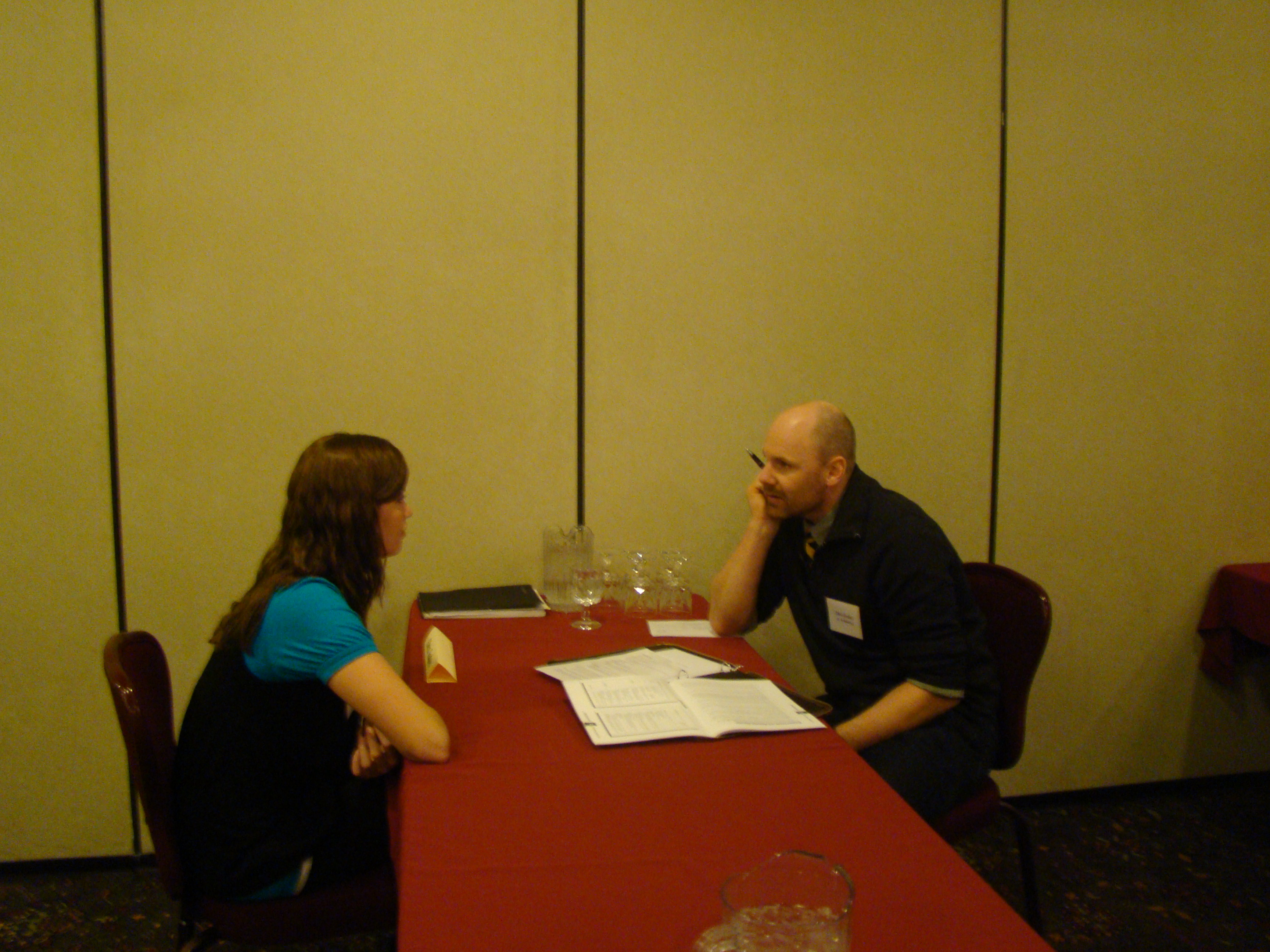 Faculty member Chris Godsey performs a mock interview with a SCC student