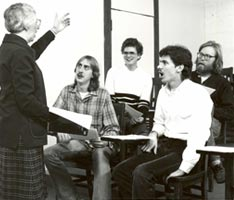 Sr. Monica Laughlin teaching to a group of students in a classroom