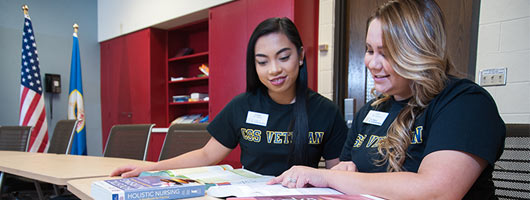 Kristel Baltazar and Amy Anderson studying in the Veteran to B.S. Nursing resource room
