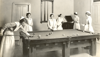 Nursing students relax with a game of billiards.
