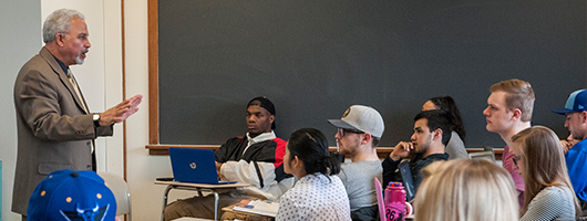 Students sitting in a classroom listening to a lecture