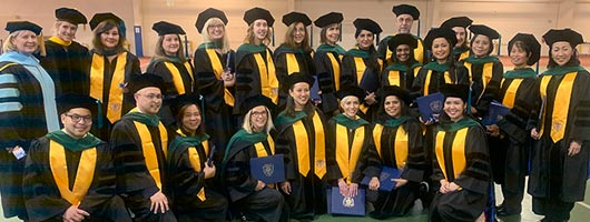 A group of tDPT graduates at Commencement