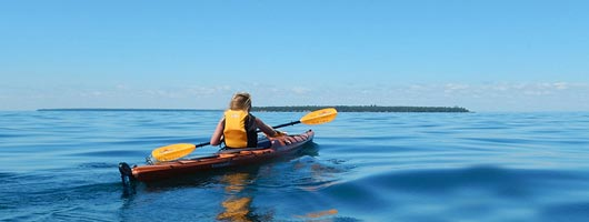 Two students kayaking on Lake Superior in Duluth, MN