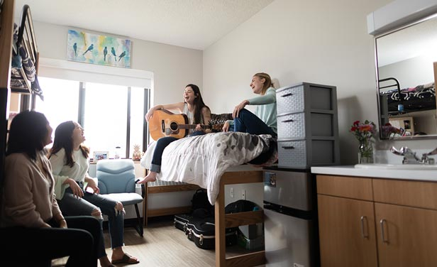 Four students hanging out in the newly renovated dorms at St. Scholastica