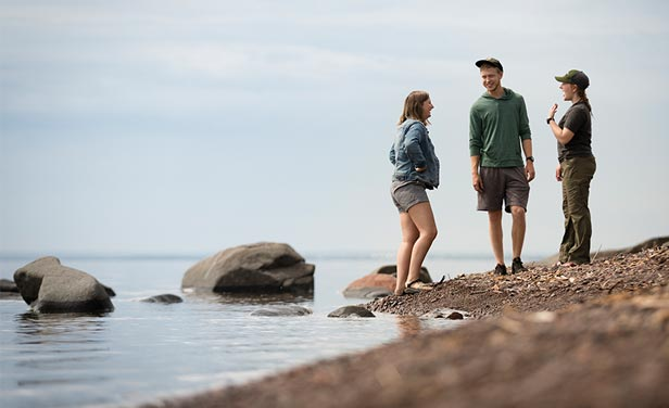 Students walking along Lake Superior in Duluth, MN