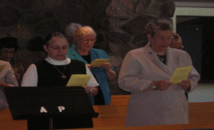 Sister Edith Bogue (on the left) communicates a Sister's perspective. Photo credit to federationsaintbenedict.org