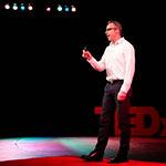Mark Garrison speaking on stage