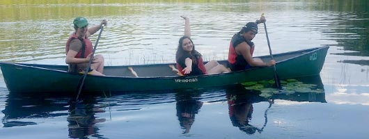 Students canoeing during the Institute