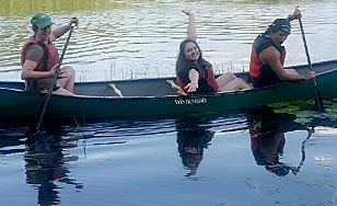 Three students canoeing during the Institute
