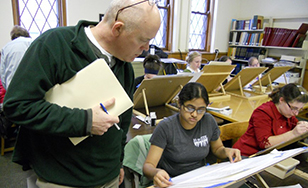 Professor Bill Hodapp works with a student during a previous bookmaking class.
