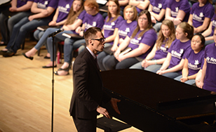 Bret Amundson directs choir members. File photo