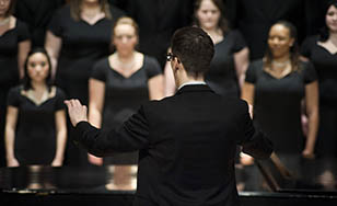 Bret Amundson directs a choir group.