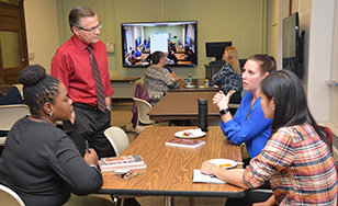 Neil Witikko leads a meeting with faculty members.