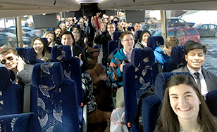 Students boarded the bus bright and early for the ride to St. Paul.