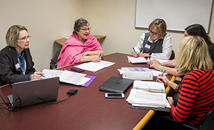 Karen Diver meets with faculty members