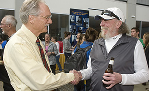 President Larry Goodwin chats with Doc C during a recent celebration of the professor's career.