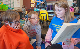 Denfeld High students are working with children at Laura MacArthur Elementary.