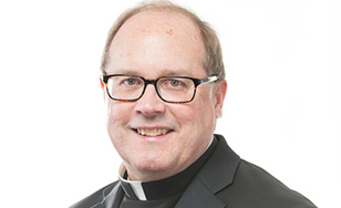 Father Eric Hollas