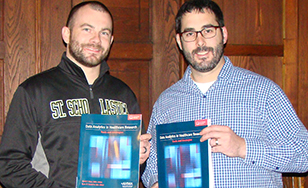 David Marc and Ryan Sandefer with their book