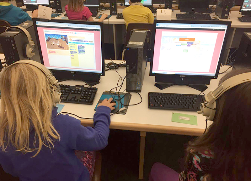 Lowell Elementary students work on tasks designed to introduce them to coding.