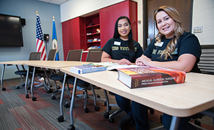 Kristel Baltazar and Amy Anderson in the Veterans Resource Room, created as part of the INVITE program