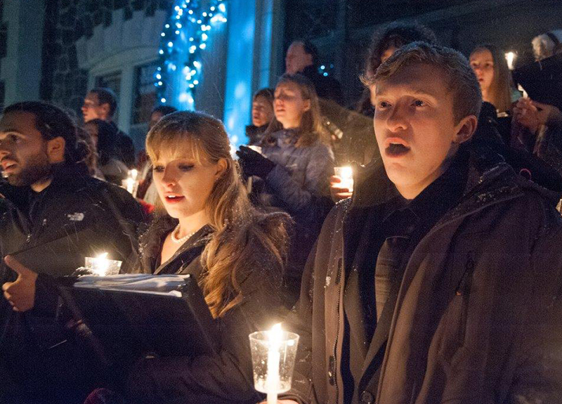 Choir members perform at the 2016 tree lighting ceremony.