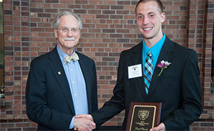 David Ohnstad receives his award from President Larry Goodwin.