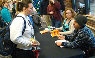 "Anna Loehrer gets her copy of ""There There"" autographed by Tommy Orange."