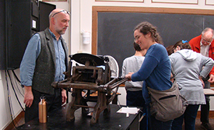 Todd White assisted with a printing workshop earlier this fall.