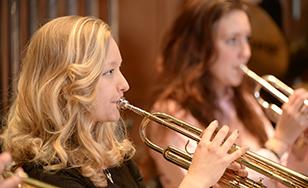 The St. Scholastica Instrumental Ensemble performs.