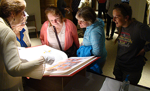 Participants viewing the Saint John's Bible at a campus event this fall.