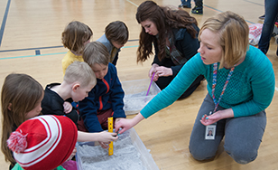 St. Scholastica students work with children at Lowell Elementary on STEM-related projects.