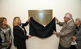 President Barbara McDonald and President Emeritus Bruce Stender unveil a plaque officially renaming the Stender School of Business and Technology.