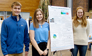 Zach Thomas, Emily Scinocca and Kyra Jackson present their research during last fall's Sustainability Showcase.