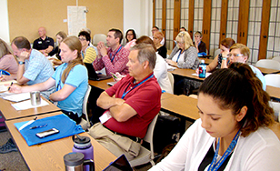 Educators attend a breakout session.