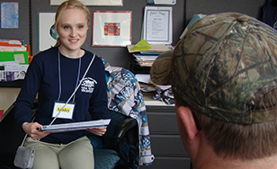 Ashley Kittelson '18 works with a client at the Community Action Duluth free tax preparation site.
