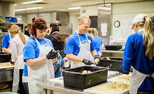Volunteers prepare food in the days leading up to the Twin Ports Thanksgiving Buffet.