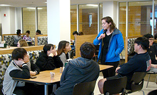 Natalia McNab from the UWS Office of International Programs talks with UWS students in the Greenview Dining Room.