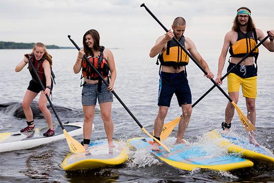 Students kayaking on Lake Superior