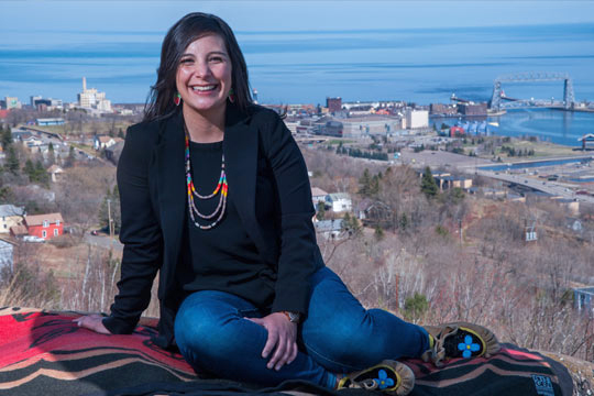 Alicia Cyr sitting on an overlook above Duluth