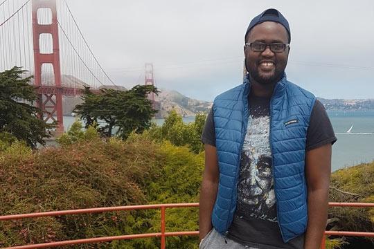 Malvern Madondo standing near the Golden Gate Bridge