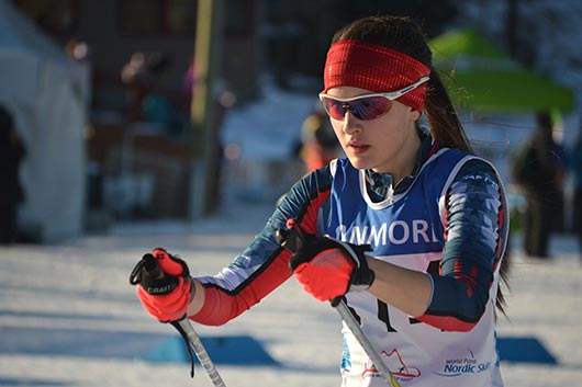 Mia Zutter skiing at Canmore at the IPC Cross-Country Skiing and Biathlon World Cup