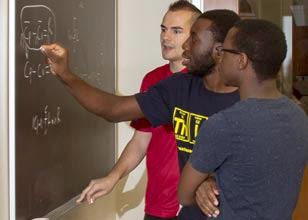 Isaac Wakiro, Paul Chazovachii and Aleksandar Radakovic working in the chemistry lab