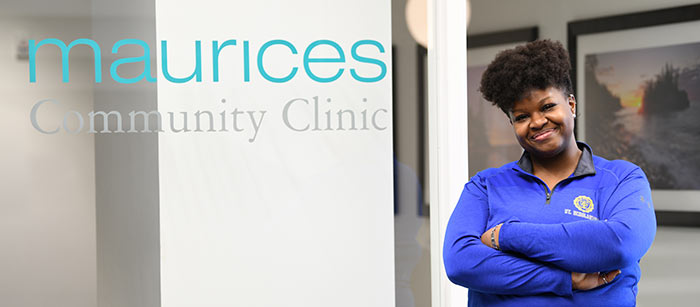 Latrice standing in front of the maurices Community Clinic