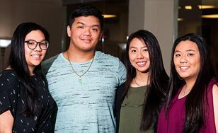 Elizabeth Tran, Michael Nguyen, Mary Tran and Julie Tran in the Intercultural Center at St. Scholastica