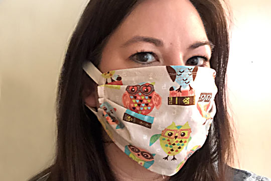 Amy Lyttle wearing one of the masks she's sewing for the healthcare crisis.