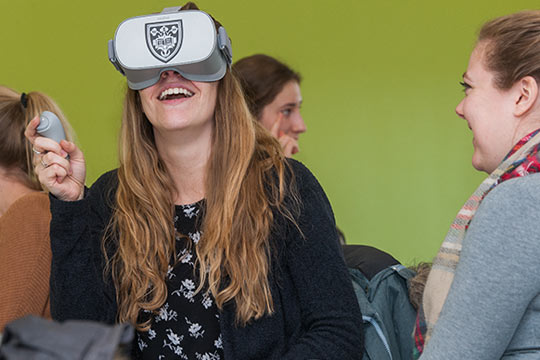 PA student Samantha Lahr uses a handheld device to navigate her VR experience