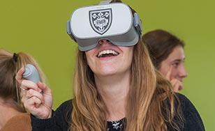 PA student using virtual reality device during a lab exercise at St. Scholastica