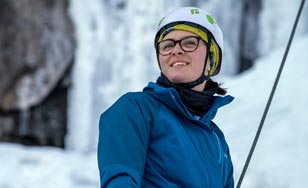 Elizabeth Becker participating in ice climbing through the Outdoor Pursuit Department at St. Scholastica.