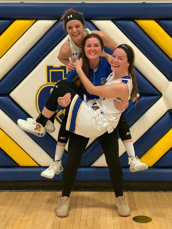 Huber sisters in the Reif Gym at St. Scholastica